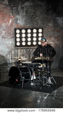 Bearded Drummer. Bearded Drummer. A Bearded Guy Plays Drums In A Beautiful Studio With Light Bulbs.