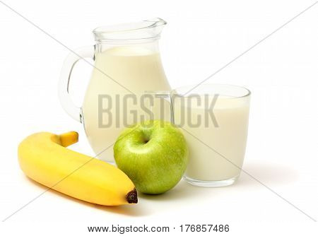 Glass jug pitcher of fresh milk with glass, apple, oatmeal and banana isolated on white background carafe