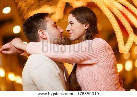 Photography of happy kissing couple enamored at mall