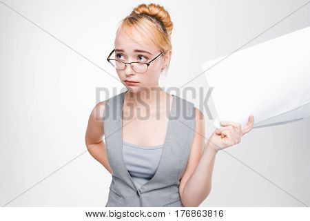 Young student girl in glasses feels disappointed and upset with bad exam results. Crushed hope, ruined dream, perplexity.