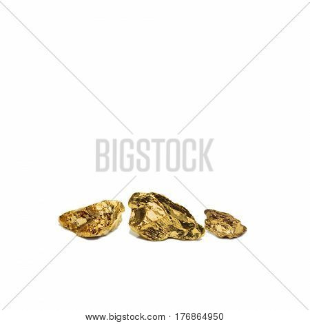 Three golden nugget closeup isolated on white