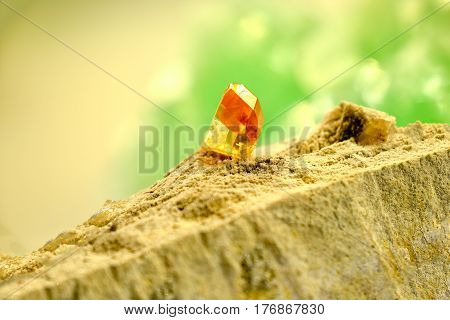 Topaz mineral in nature on a rock