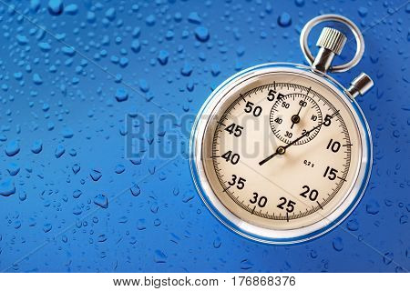 Stopwatch  placed on blue background in closeup