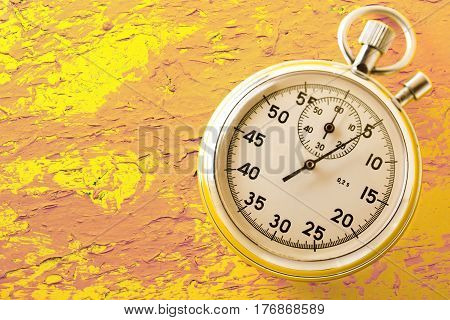 Stopwatch  placed on yellow background in closeup