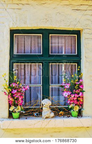 Beautiful window in the old house of small European city