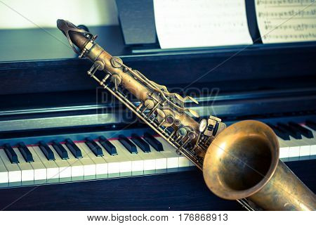 Saxophone on piano, swing, jazz, woodwind, key
