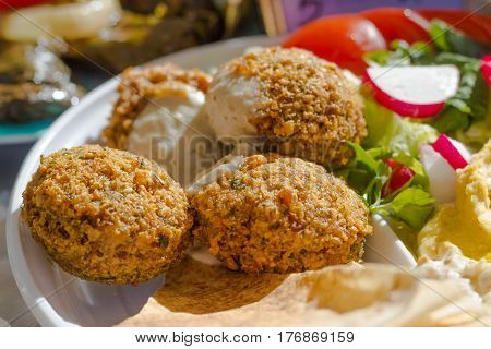 freshly cooked falafel fritters, pita and salad