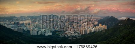 Landscape of Hong kong and Kowloon in sunrise morning with mist and mountain Hongkong China Asia