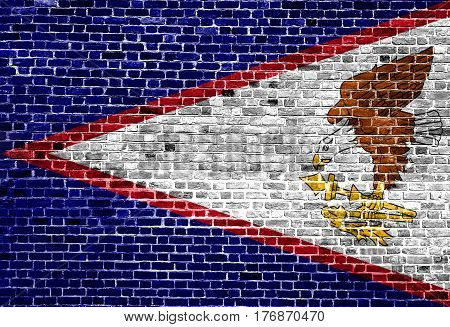 Flag of American Samoa painted on brick wall, background texture