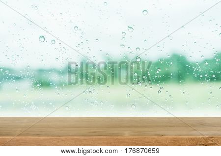 Empty Wooden Table Top With Glass Wall And Water Drop Background.