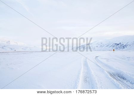 Winter snowy road in the mountains, Iceland.