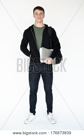 Young student boy holding school textbook