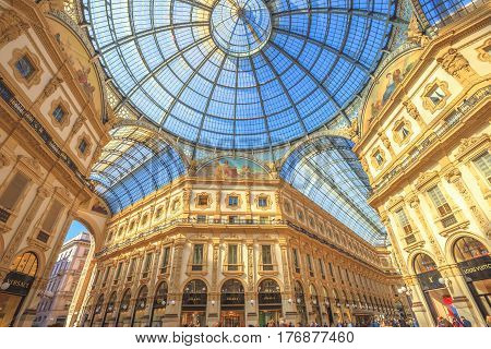 MILAN, ITALY- MARCH 7, 2017: vault cupola of the Galleria Vittorio Emanuele II arcaded mall in Dome square. Famous fashion stores like Prada.