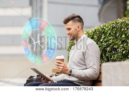 business, astrology, horoscope, technology and people concept - creative man with tablet pc computer and pisces zodiac sign drinking coffee from paper cup and sitting on city street bench