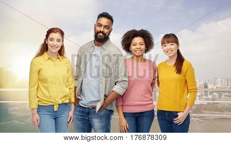 diversity, race, ethnicity and people concept - international group of happy smiling men and women over singapore city background