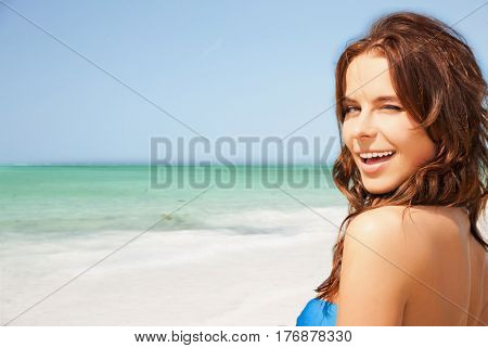 people, summer holidays, vacation and travel concept - happy smiling young woman enjoying sun over exotic tropical beach and sea shore background