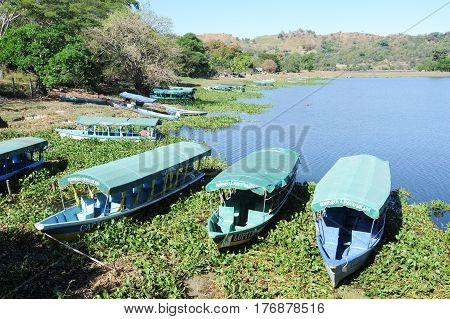 Suchitoto, El Salvador - 18 January 2014: Boats at Puerto San Juan on lake Suchitlan near Suchitoto on El Salvador