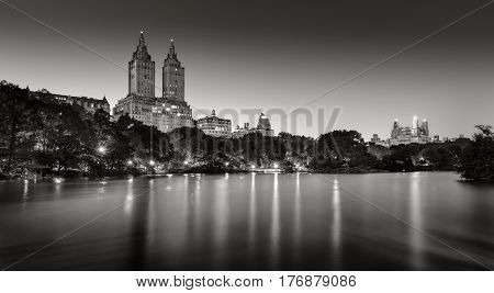 Central Park and city lights across The Lake at twilight. Black & White. Upper West Side Manhattan New York City