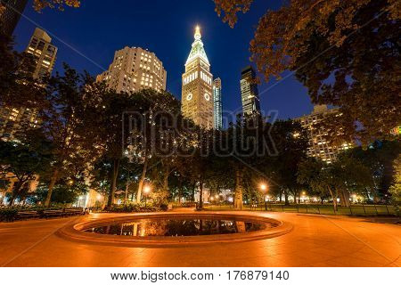 Madison Square Park in summer at twilight. Midtown skyscrapers Manhattan New York City