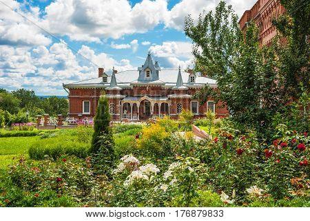 Beautiful ancient house among flowers in Kazan Amvrosievskaya stauropegic female desert in Shamordino