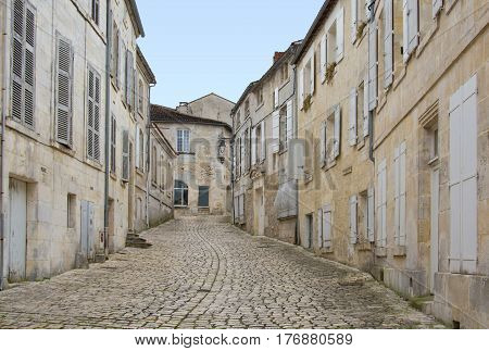 A paved alley of Cognac in France