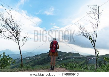 Hiker woman feeling victorious facing on the mountain Thailand