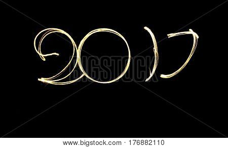 Happy new year 2017 text written with Sparkle fireworks isolated on black background