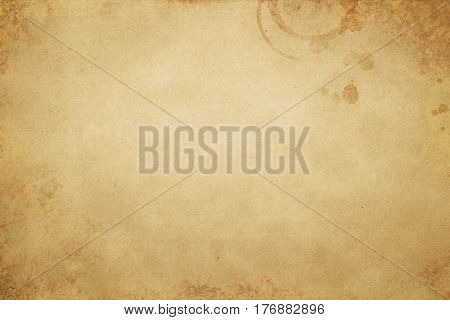 Old stained paper background or texture for the design.Grunge paper texture.