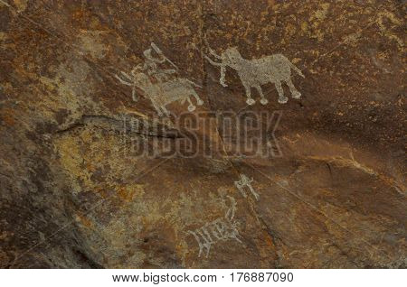 Bhimbetka rock shelters, Madhya Pradesh, India- January 22, 2016: A Prehistoric rock painting showing a men with two Elephants at Bhimbetka archaeological site at Raisen, Madhya Pradesh, India.