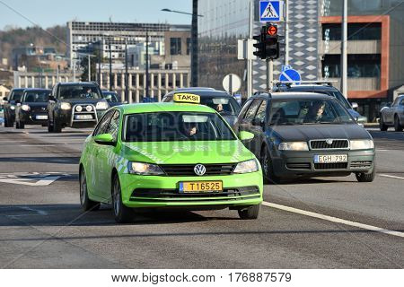 VILNIUS MARCH 16: Vilnius taxi in the city street on March 16 2017 in Vilnius Lithuania. Vilnius is the capital of Lithuania and its largest city.