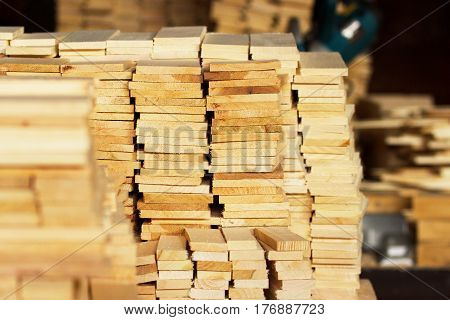 Wood timber construction material closeup for background and texture. Stack of wooden blanks at the sawmill.