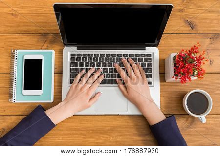 Top view business using laptop in office. Freelancer working with portable computer in coffee shop during the morning