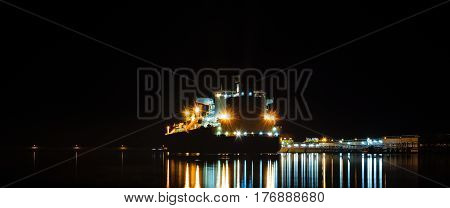 LNG TANKER AT THE GAS TERMNAL - seaport at night