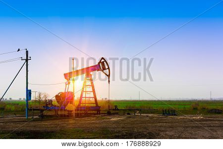 Oil derrick. Oil production, tower pumping in field