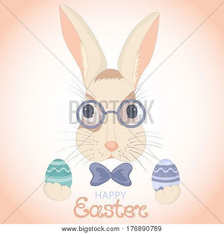 The Easter bunny in glasses and with a bow holds paschal eggs in rabbits paws.