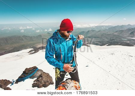 Man alpinist with ice axe climbing in mountains Travel Lifestyle endurance concept adventure active vacations outdoor mountaineering sport