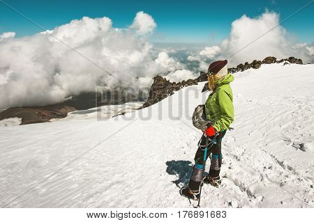 Woman alpinist climbing in mountains glacier Travel Lifestyle success concept adventure active vacations outdoor mountaineering sport alpinism equipment clouds on background
