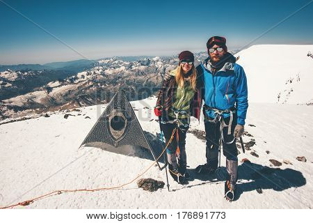 Couple Man and Woman climbing reached Elbrus mountain east summit Travel Lifestyle success concept adventure active vacations together outdoor mountaineering sport happy emotions
