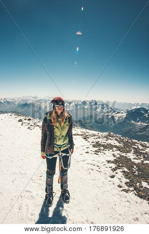 Woman climber reached Elbrus mountain summit Travel Lifestyle success concept adventure active vacations outdoor happiness emotions enjoying peaks range landscape