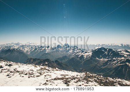 Aerial view landscape from Elbrus mountain summit to Greater Caucasus mountains range blue sky climbing Travel serene scenery wild nature calm atmospheric scene sunny day 5621m altitude