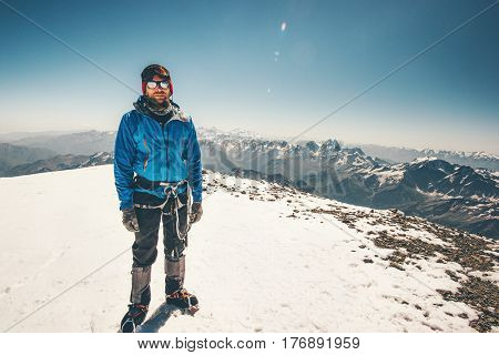 Climber Man reached Elbrus mountain east summit Travel Lifestyle success concept adventure active vacations outdoor mountaineering sport aerial view Greater Caucasus range
