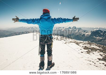Climber Man on Elbrus mountain east summit Travel Lifestyle success concept adventure active vacations outdoor mountaineering sport happiness emotions traveler raised hands