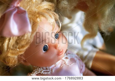 Cute plastic doll with bow. Close up.
