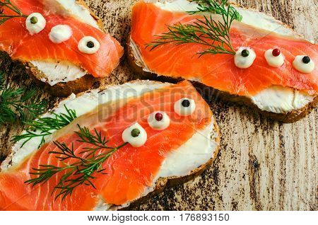 Sandwich with smoked salmon and dill. Close-up.