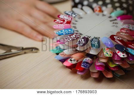 Set of different nail polish colours on palette in cosmetic store. Nails art accessories