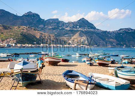 People Near Boats On Beach In Giardini Naxos Town