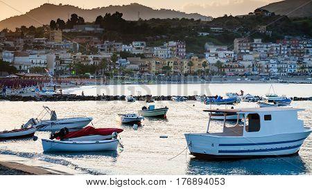 Boats In Marina Of Giardini Naxos Town In Evening