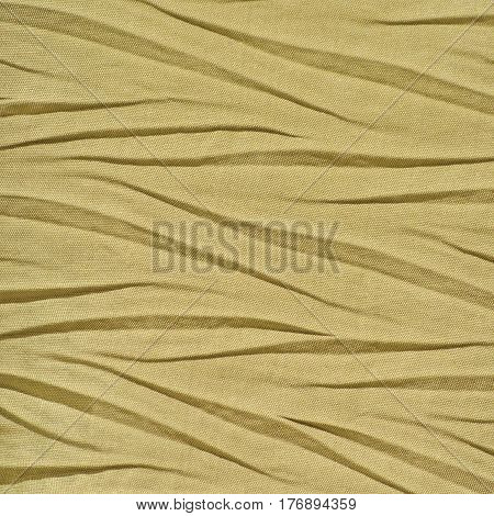 Yellow Golden Crumpled Synthetic textile Creased Polyester Fabric Detail Horizontal Decorative Wrinkled Texture Pattern Bright Large Detailed Textured Swatch Background Gentle Bokeh Accents