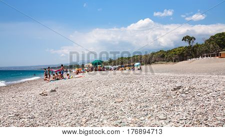 Tourists On Pebble Beach San Marco On Ionian Sea