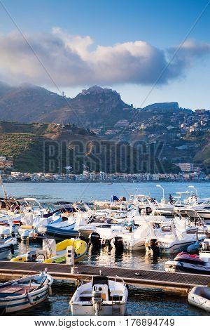 Yacht Mooring In Giardini Naxos Town In Evening